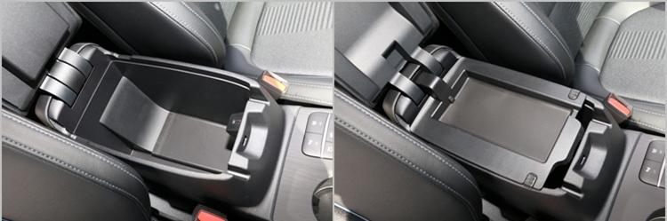 中央扶手具有兩段收納設計,無論放置手機或大小雜物都很方便。